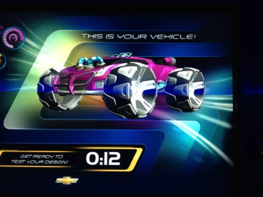 The interactive queue is a lot of fun and helps pass the time. We built a custom car for the test track … powerful & pink!